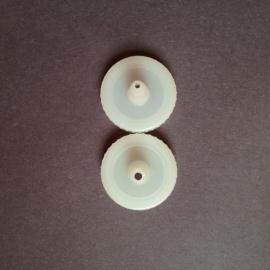 (Top) Stock Wilton squeeze bottle cap , (Bottom) Trimmed cap