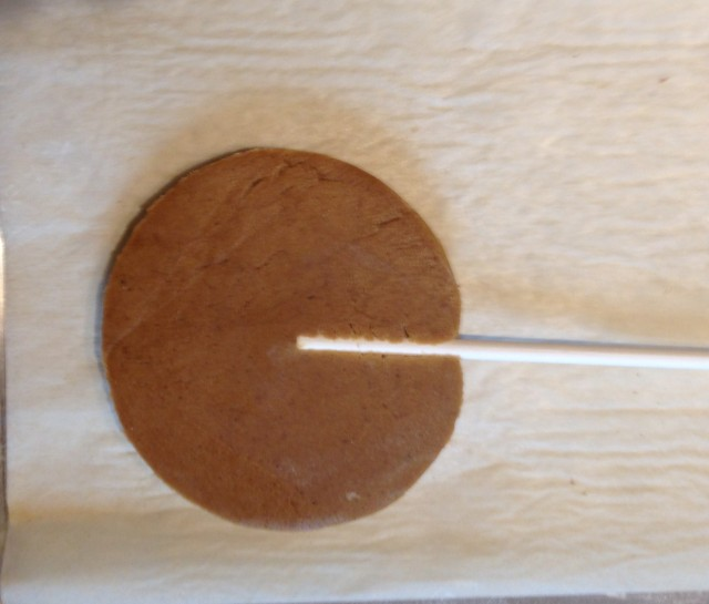 Back of cookie with stick, unbaked